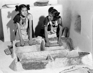 Girls Grinding Corn in Puberty Ceremony,  Shungopovi Village-2nd Mesa. Left, Belvera Nuvamsa, Right, Mary Anna Nuvakaku, June 28, 1949. HCPO.PH.2003.1.HH1.3