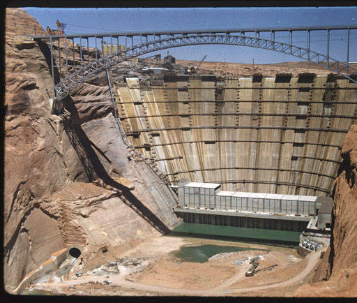 """Construction of Glen Canyon Dam [constructed title], 1963. </br><a href=""""http://cdm16748.contentdm.oclc.org/cdm/ref/collection/cpa/id/18235"""" target=""""_blank"""">William G. Bass Collection NAU.PH.96.24.47.99</a>"""