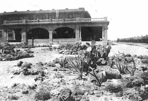 "[Escalante Hotel and railroad station, Ash Fork, Ariz.]</br><a href=""http://cdm16748.contentdm.oclc.org/cdm/ref/collection/cpa/id/5967"" target=""_blank"">Joseph Bean and Laura Tappan Collection NAU.PH.660.90</a>"
