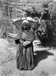 "Havasupai woman with burden basket full of agave hearts.</br><a href=""http://cdm16748.contentdm.oclc.org/cdm/ref/collection/cpa/id/72551"" target=""_blank"">Cataract Canyon Collection NAU.PH.90.15.29</a>"