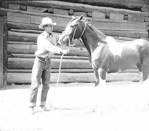 "[Loren 'Tiny' Lauzon with paint horse in front of barn at White House, Grand Canyon.] </br><a href=""http://cdm16748.contentdm.oclc.org/cdm/ref/collection/cpa/id/4272"" target=""_blank"">Lauzon Family Collection NAU.PH.96.3.14.25</a>"