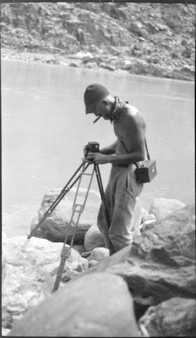 "USGS River Trip, 1923, Man [E. C. La Rue] with Instrument [Camera and Tri-pod].</br><a href=""http://archive.library.nau.edu/cdm/ref/collection/cpa/id/23498"" target=""_blank"">Emery Kolb Collection 	NAU.PH.568.3230 </a>"