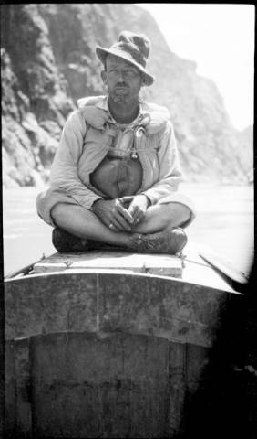 "USGS crew member of the 1923 Grand Canyon survey aboard his boat</br><a href=""http://archive.library.nau.edu/cdm/ref/collection/cpa/id/71663"" target=""_blank"">Emery Kolb Collection NAU.PH.568.807</a>"