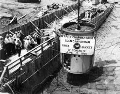 """[1st bucket of concrete at Glen Canyon Dam, lowered by Secretary Fred. A. Seaton]</br><a href=""""http://cdm16748.contentdm.oclc.org/cdm/ref/collection/cpa/id/7015"""" target=""""_blank"""">Glen Canyon Dam Project Collection NAU.PH.90.13.4</a>"""