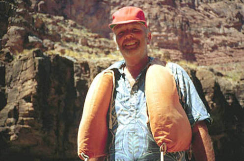"""[Bill Belknap in Cataract Canyon.] </br><a href=""""http://archive.library.nau.edu/cdm/ref/collection/cpa/id/4637"""" target=""""_blank"""">Bill Belknap Collection NAU.PH.96.4.293.115</a>"""