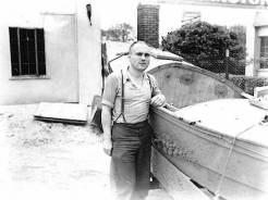 "[Buzz Holmstrom next to one of his boats, returning from Minneapolis.]</br><a href=""http://archive.library.nau.edu/cdm/ref/collection/cpa/id/3837"" target=""_blank"">Buzz Holmstrom Collection NAU.PH.97.22.9.7</a>"