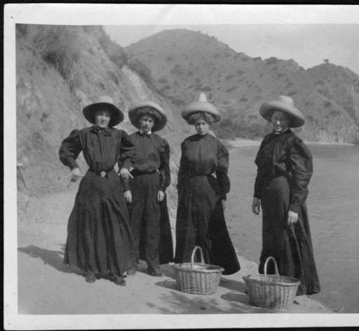 "Four Harvey Girls at the foot of the Bright Angel Trail, Grand Canyon, Colorado River mile 87.7</br><a href=""http://archive.library.nau.edu/cdm/ref/collection/cpa/id/70501"" target=""_blank"">Emery Kolb Collection NAU.PH.568.580</a>"