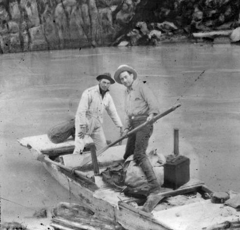 """Kolb Brothers Unloading Their Boat at Spencer Canyon, after the Rescue Search for Bessie and Glen Hyde [image is reversed]. </br><a href=""""http://archive.library.nau.edu/cdm/ref/collection/cpa/id/16130"""" target=""""_blank"""">Emery Kolb Collection NAU.PH.568.9037</a>"""