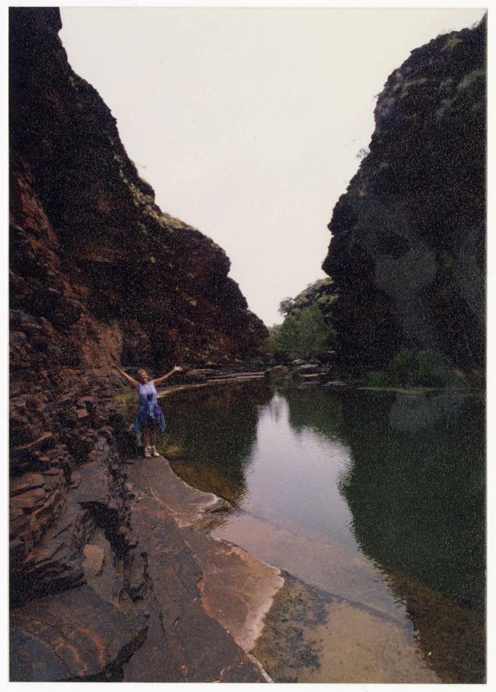 Katie Lee standing next to water
