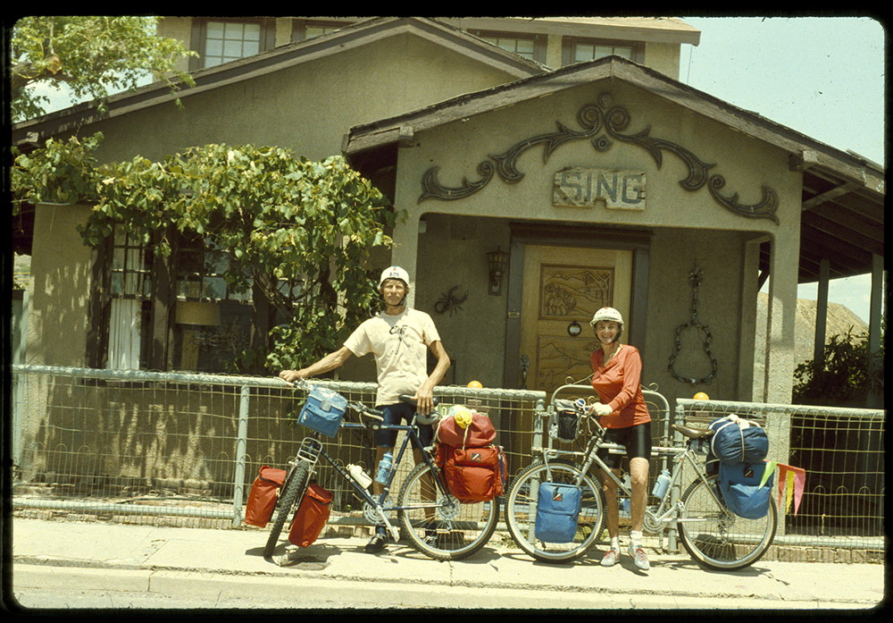Katie and Joey on bikes outside their Jerome house
