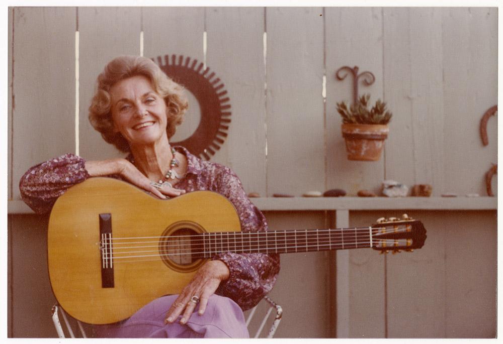 Katie Lee with guitar