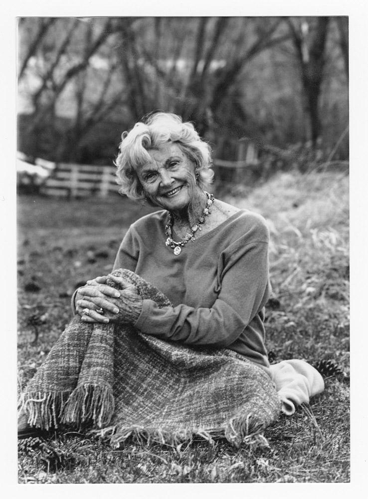 Katie Lee sitting in a field