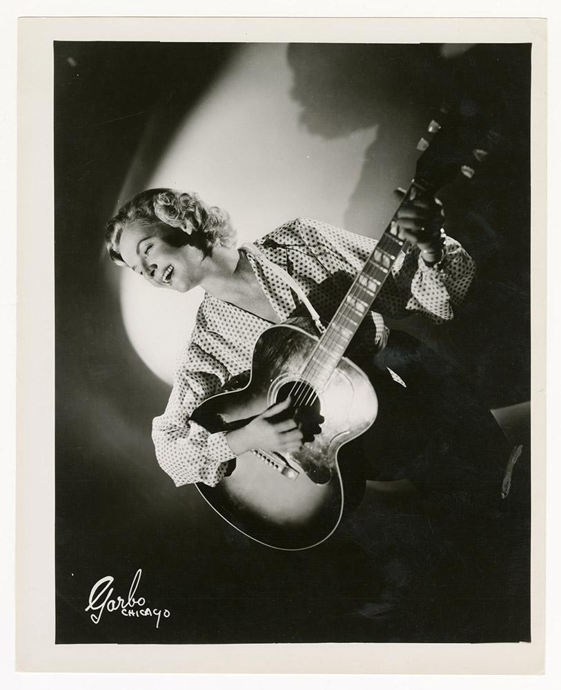 Katie Lee playing guitar