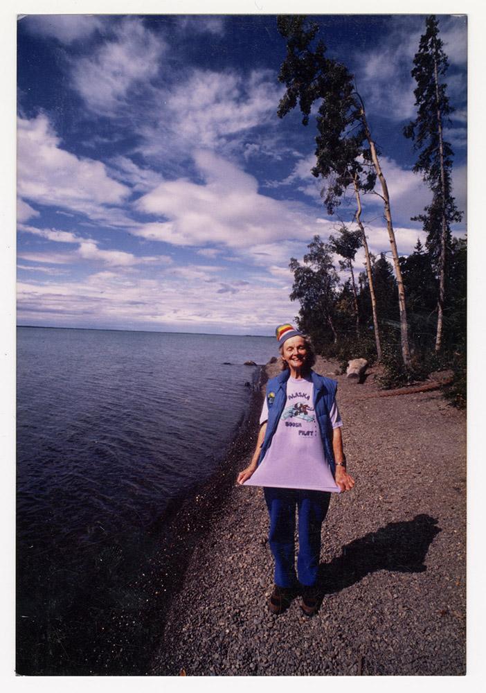 Katie Lee standing next to lake